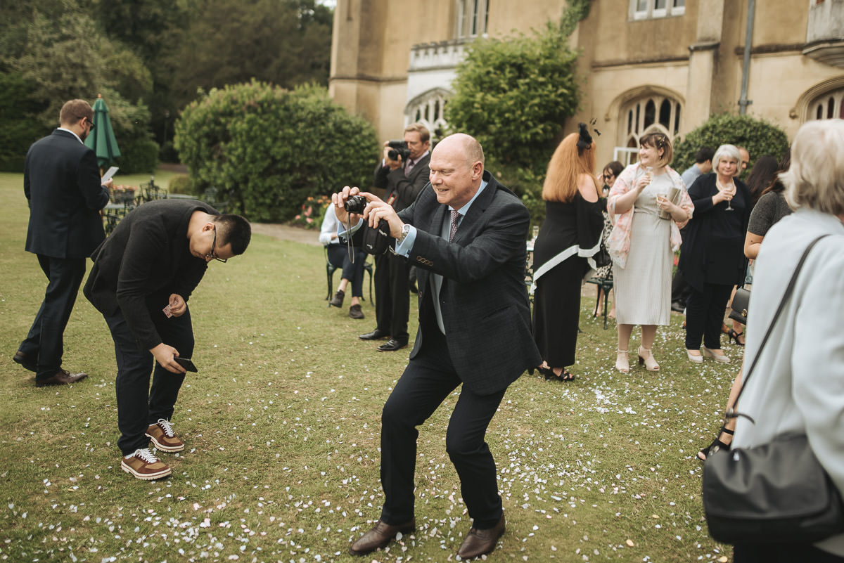 missenden abbey wedding guest with camera