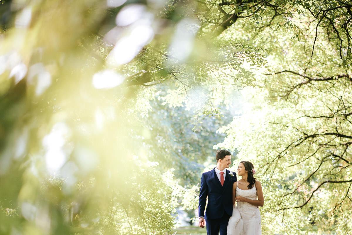 regents park london wedding couple shots holding hands