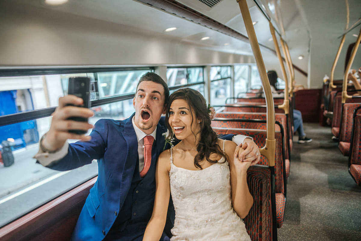 city london wedding bride and groom on the bus