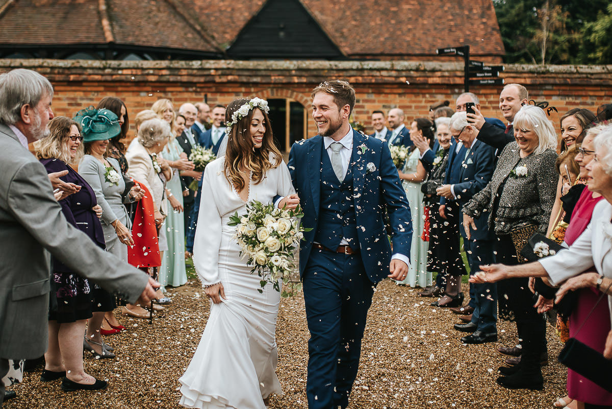 bride and groom showerd with confettin at lillibrooke manor
