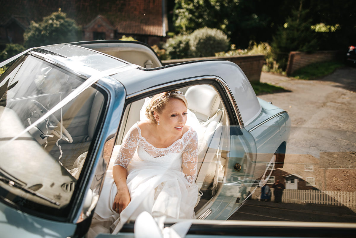 bride in the car by lincolnshire wedding photographer