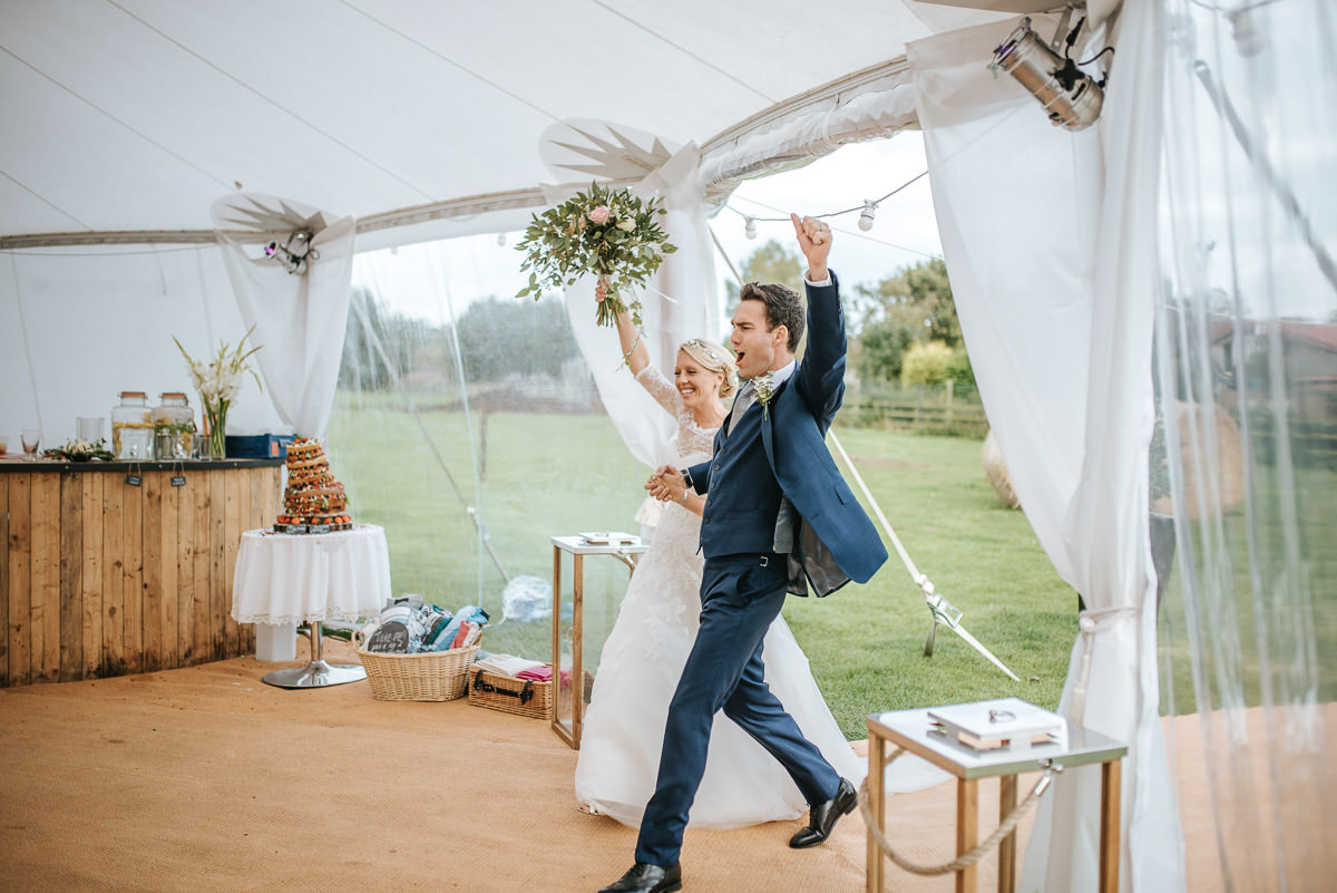 bride and groom entrance by lincolnshire wedding photographer