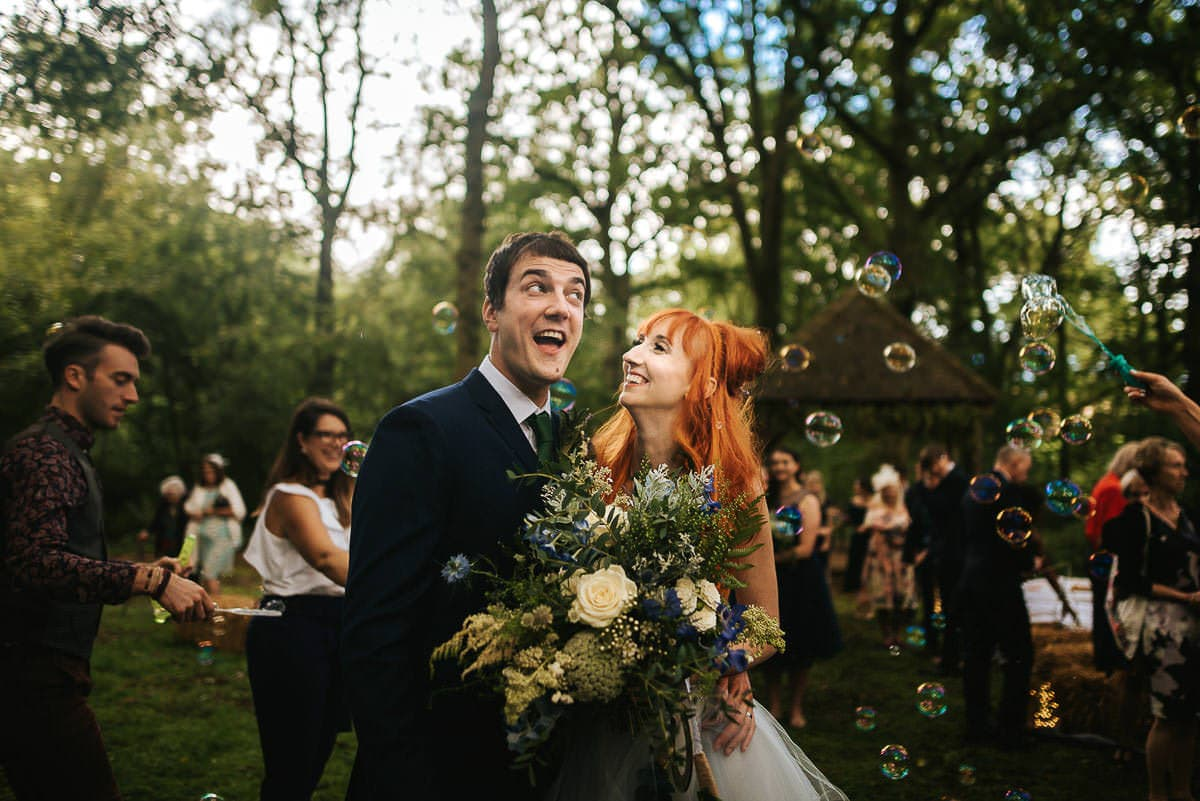 ginger hair bride and wedding bubbles