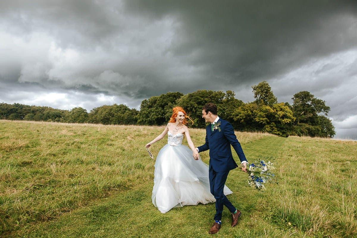 wedding couple running