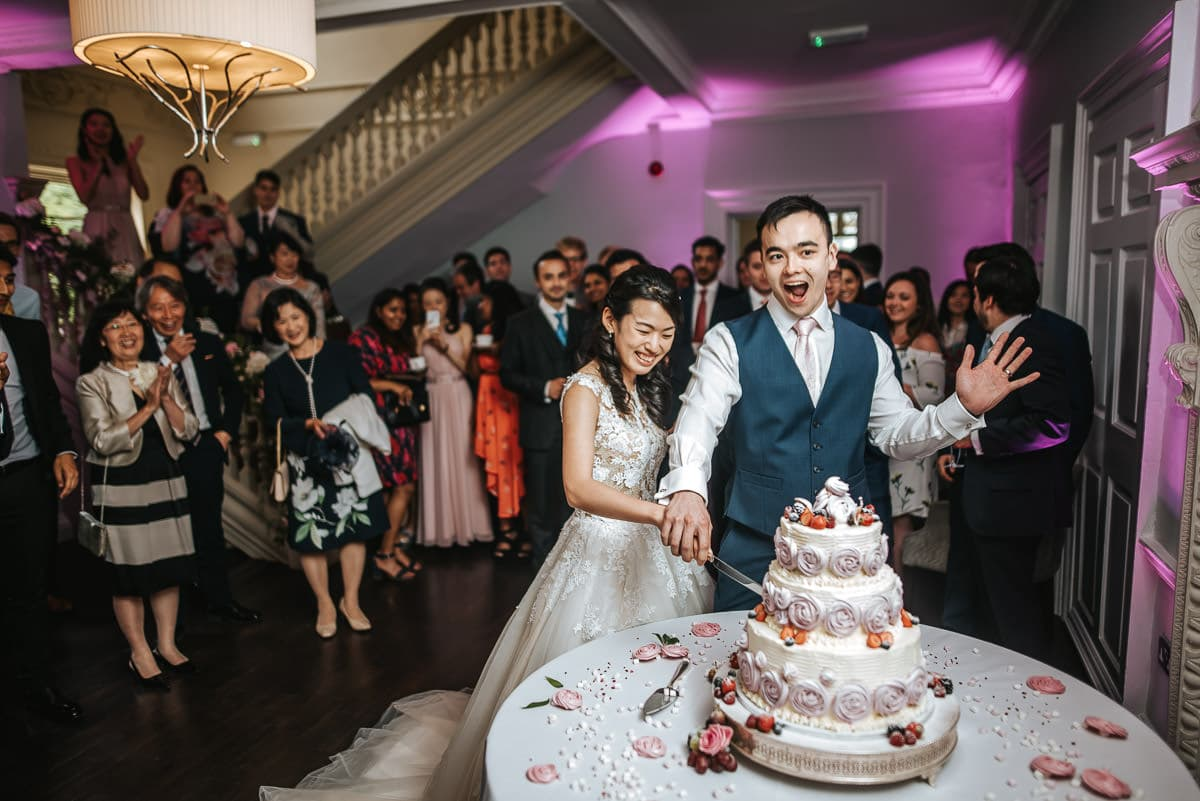 morden hall wedding cutting the cake