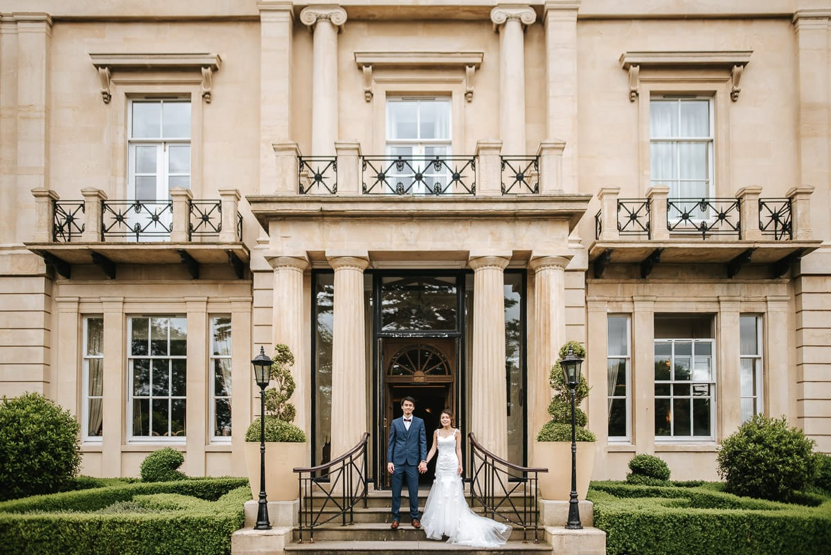 somerset wedding photography couple hand in hand on the steps