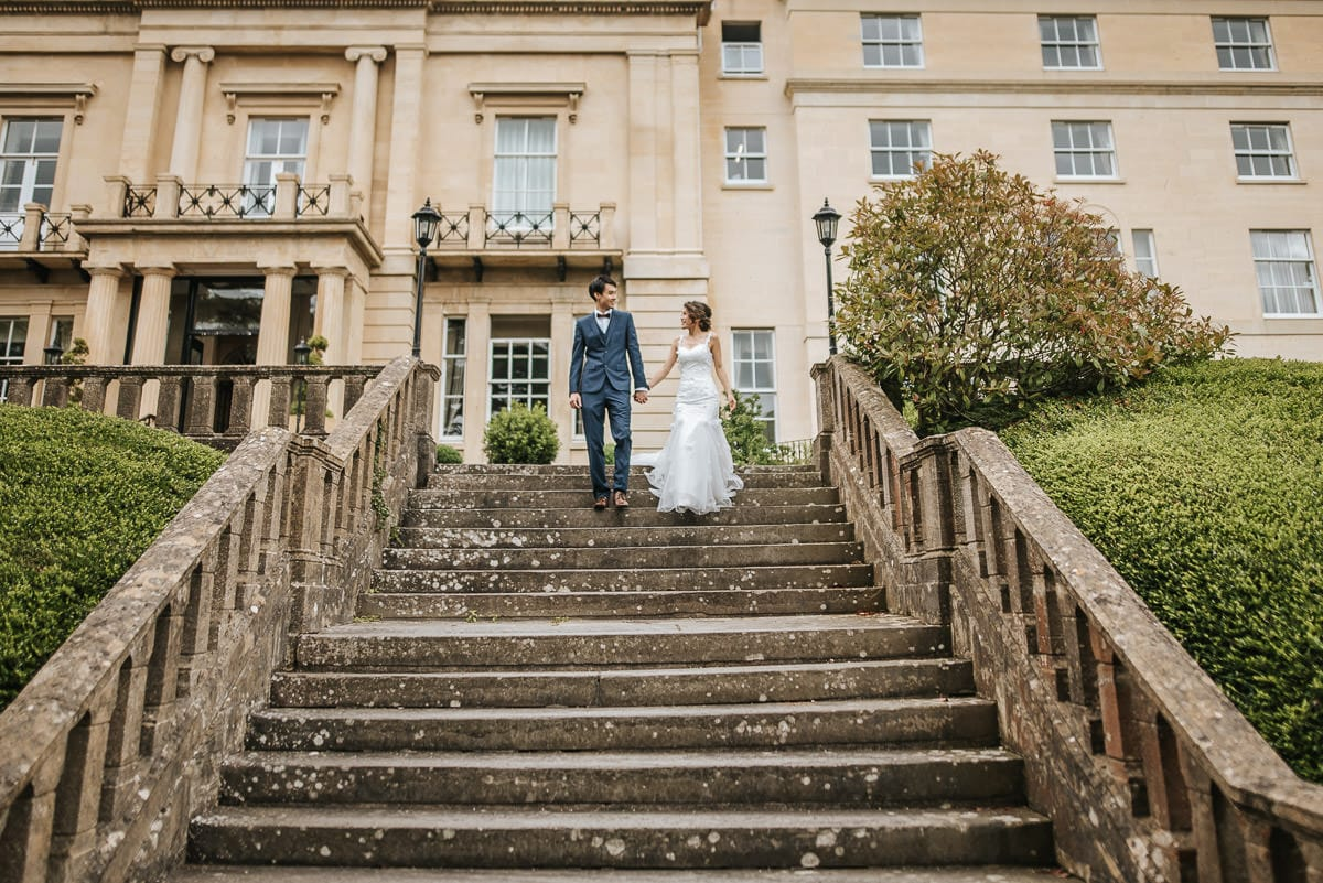 somerset wedding photography couple walking down the stairs