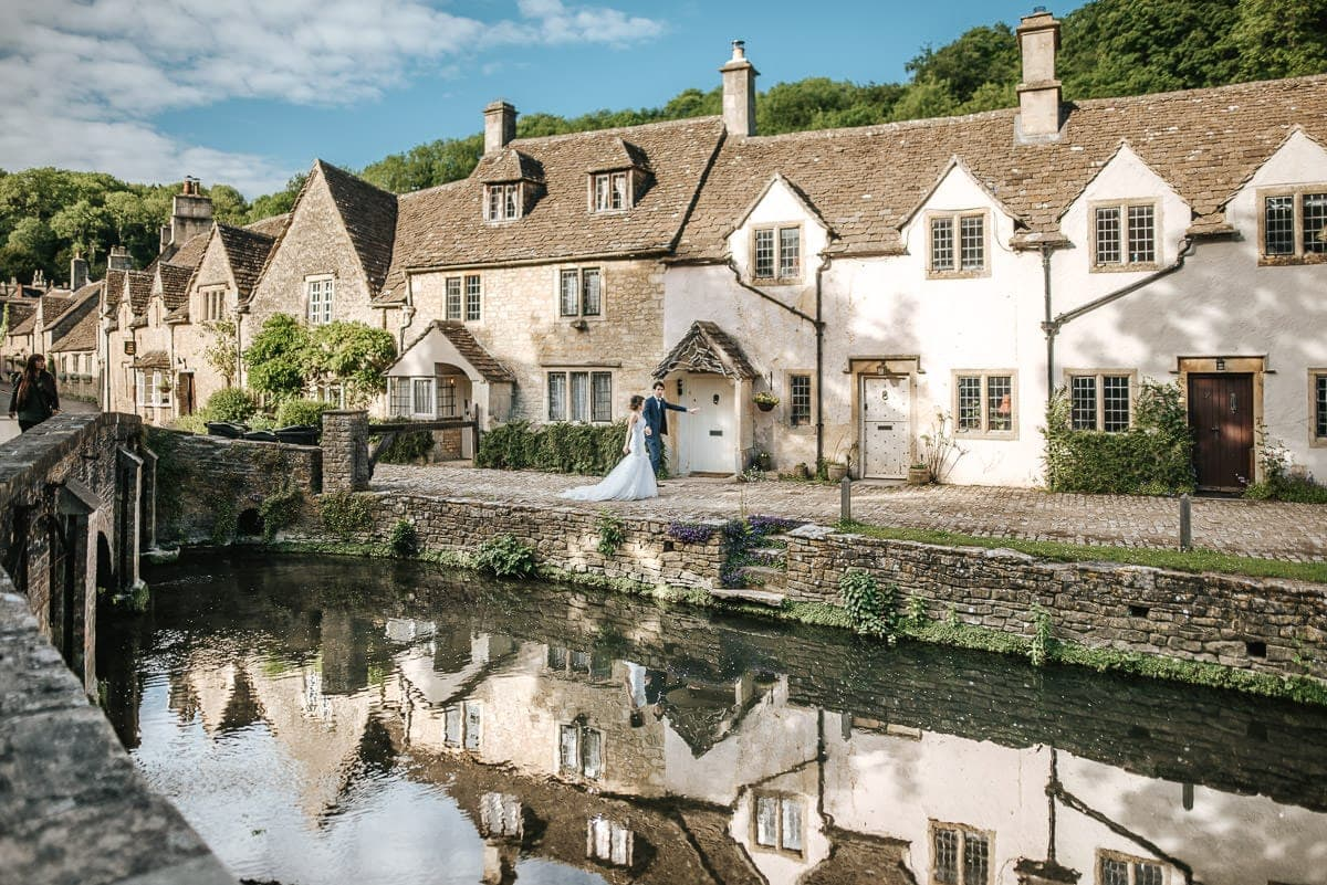 wedding couple strolling at castle combe