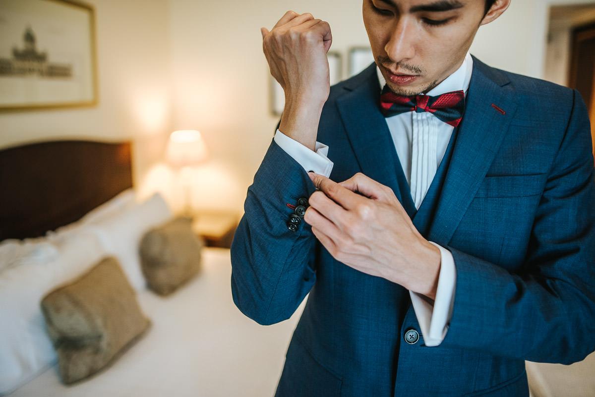 groom getting ready during wedding in bath