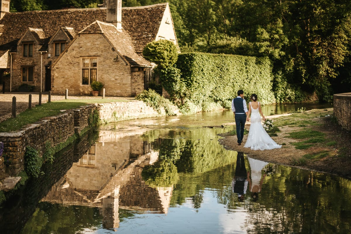 wedding couple by the stream at castle combe