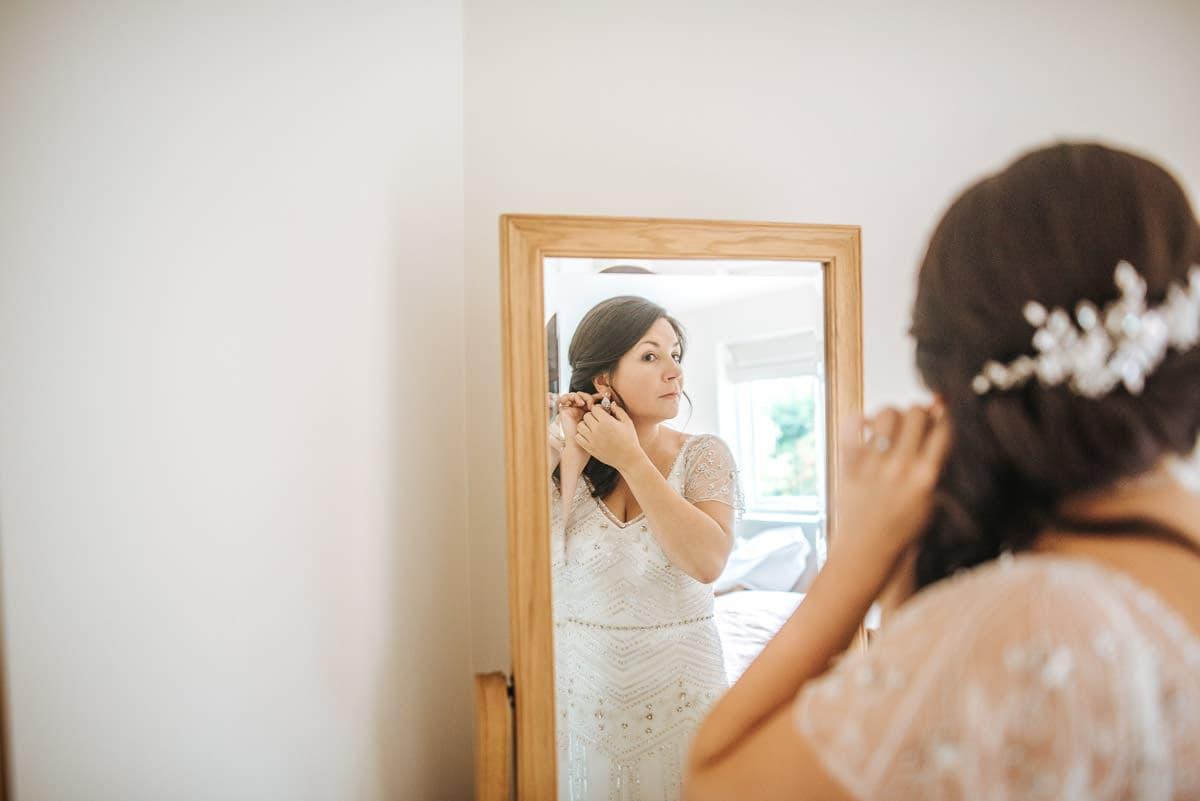 getting ready berkshire wedding earrings on