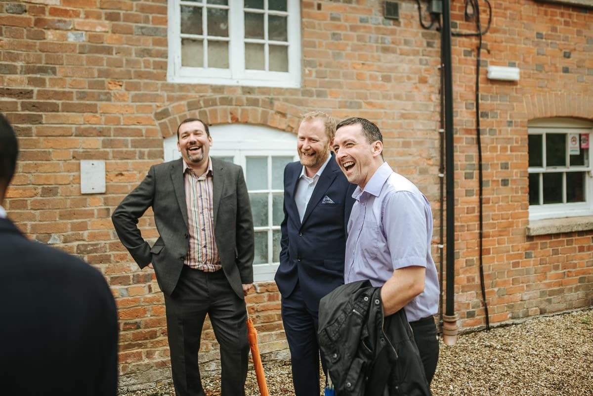 secret walled garden berkshire wedding guests laughing