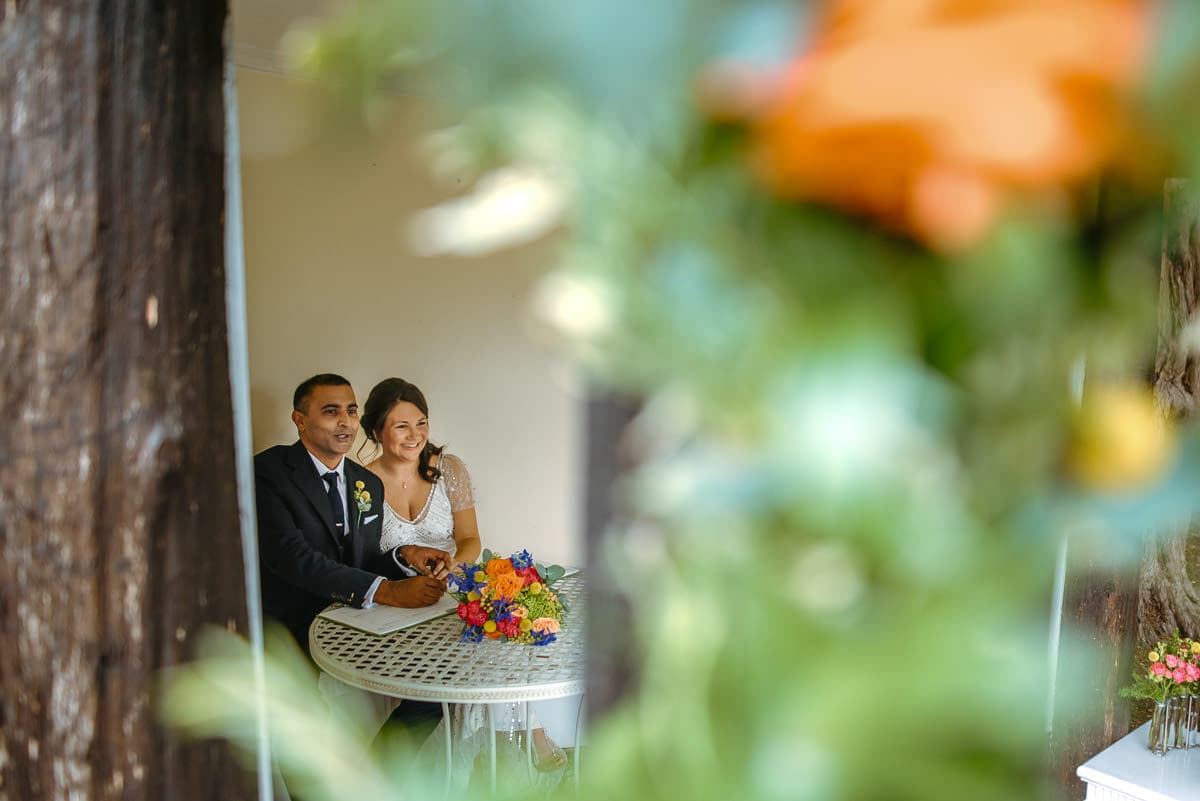 tipi wedding berkshire bride and groom signing the register