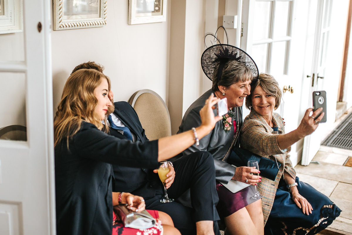 winchester wedding guest laughing selfies