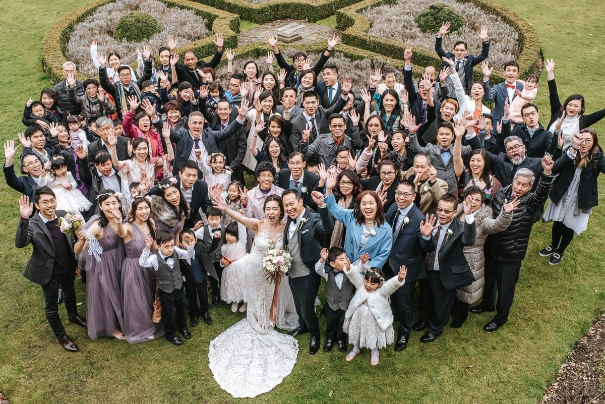 chinese wedding london hall place bexley bride and groom group shot