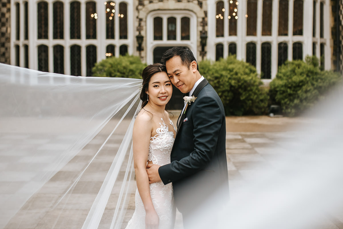 chinese wedding london hall place bexley bride and groom veil shot