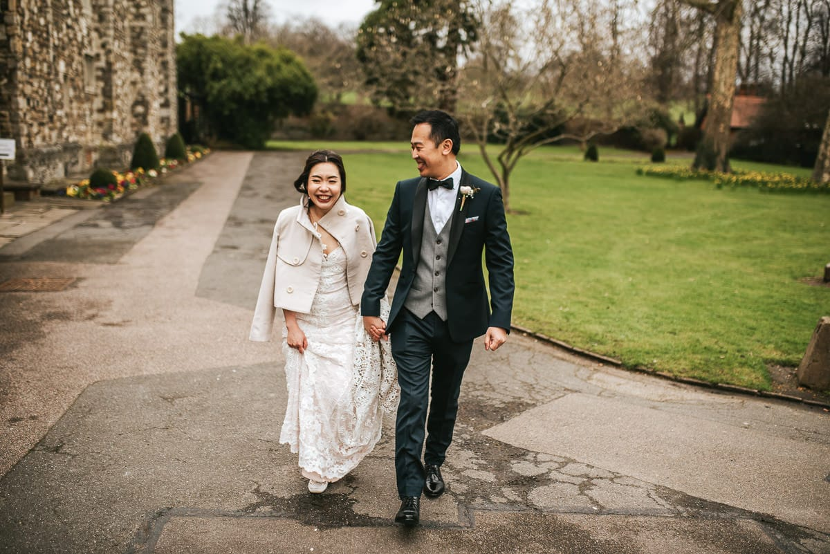 chinese wedding london hall place bexley bride and groom walking