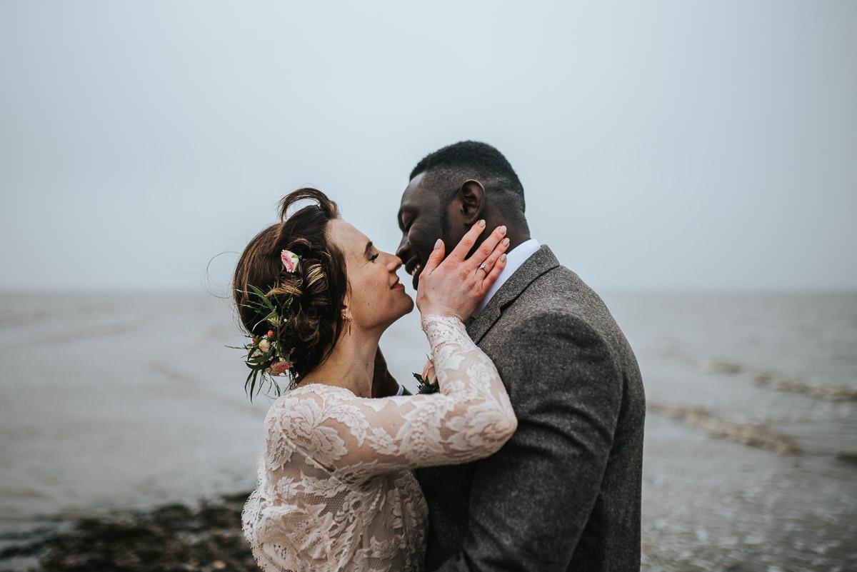 east quay venue wedding kiss