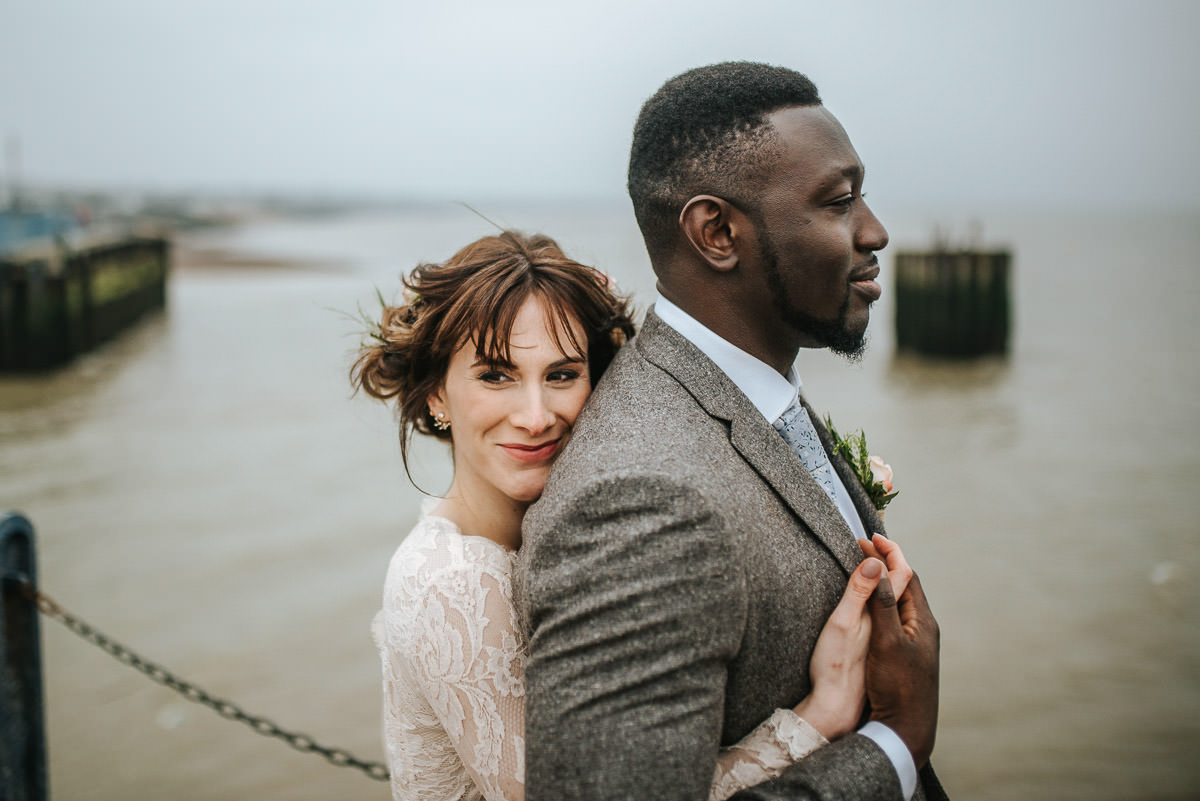 east quay venue wedding bride and groom by the pier