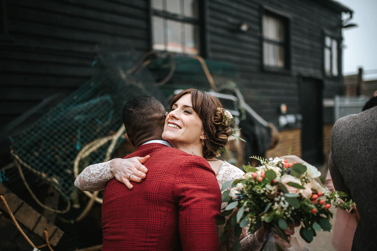 east quay venue wedding hug