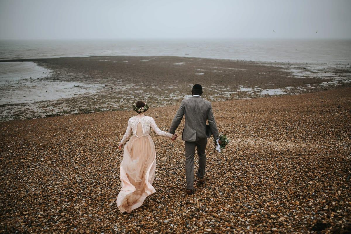east quay venue wedding bride and groom waliking