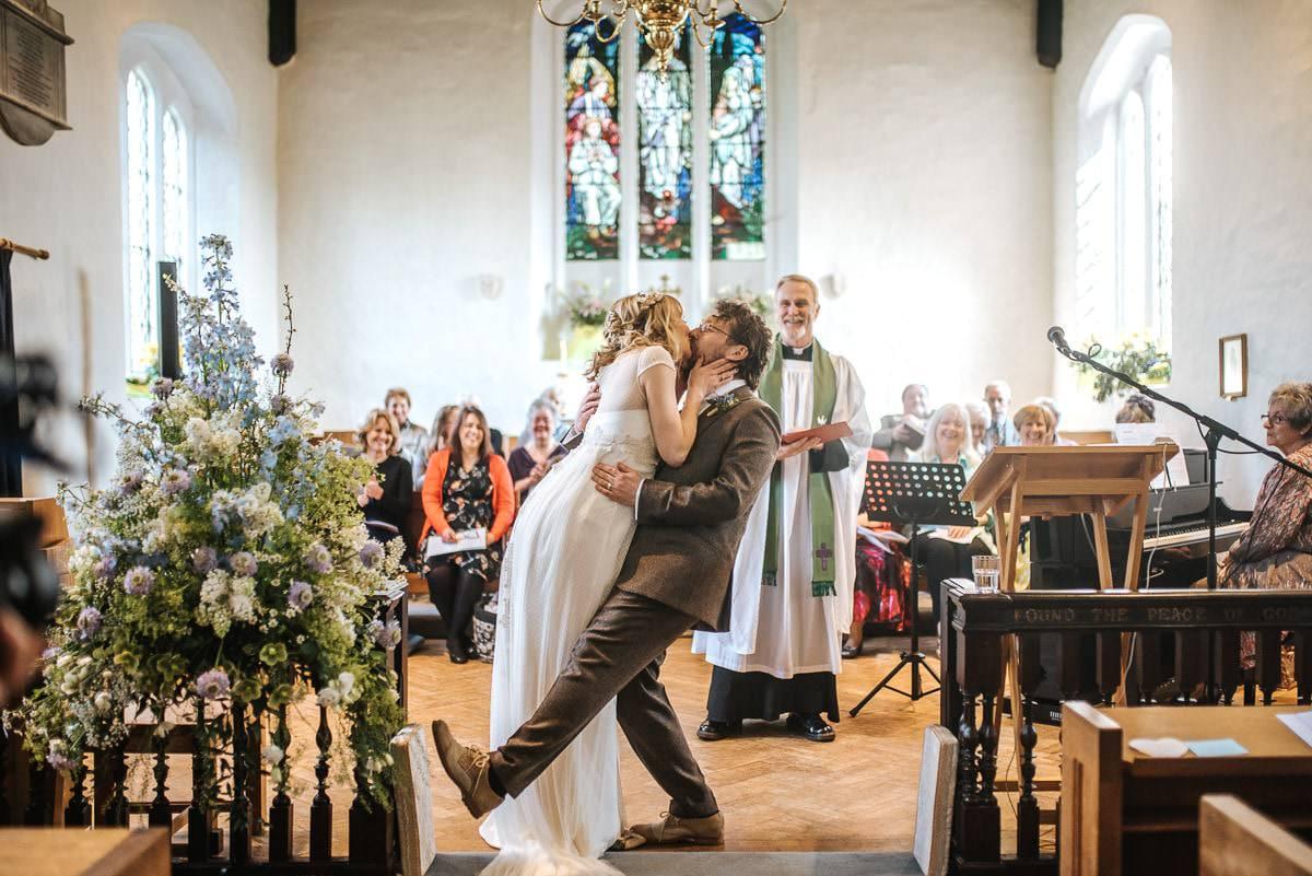 essex documentary wedding photography church kiss