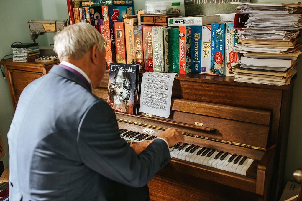 gay wedding photography dad playing piano
