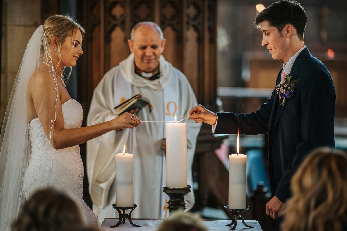 kent wedding photography lighting a candle