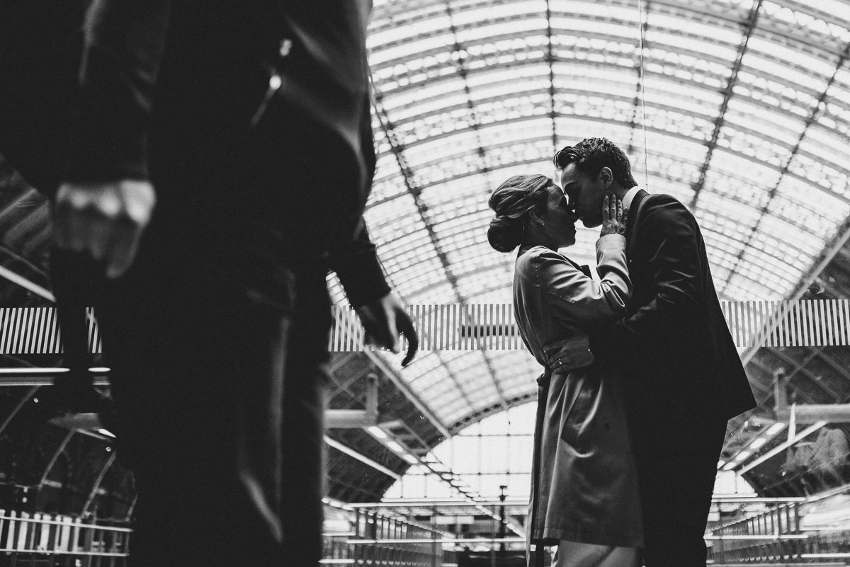 london engagement photography kings cross kissing at the station