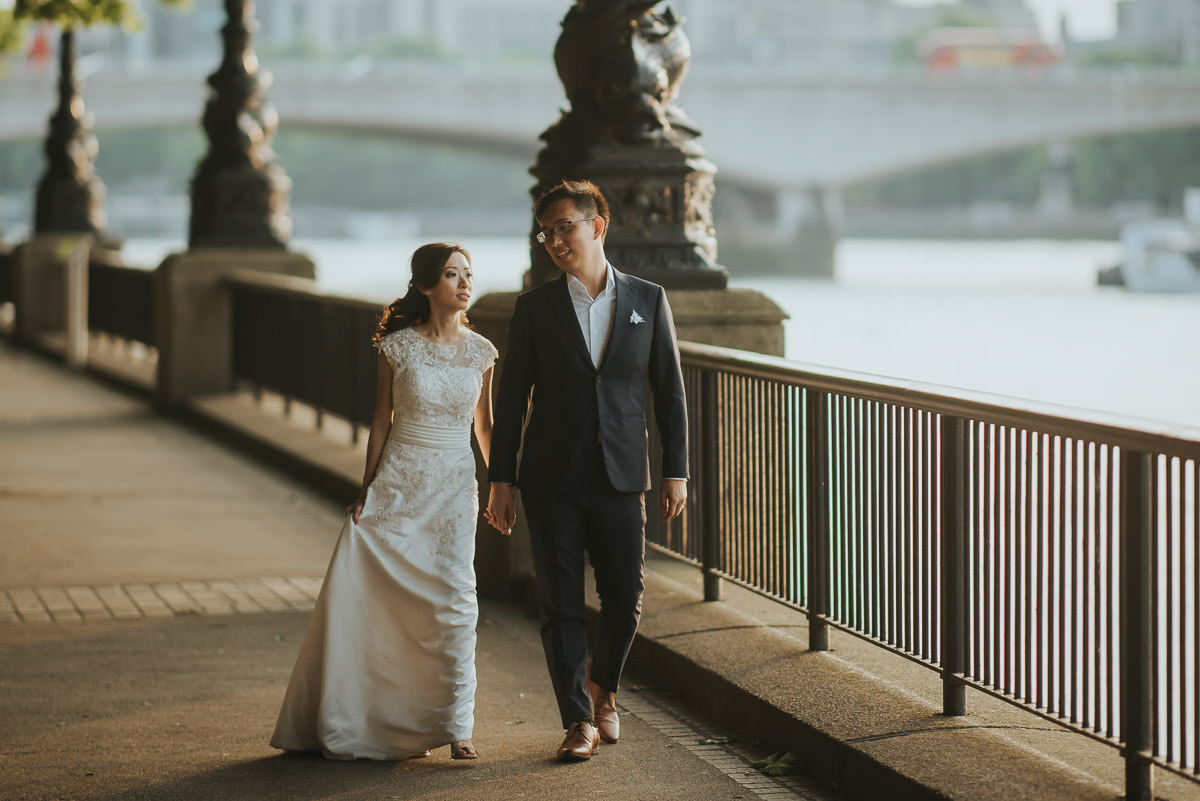 london engagement photography south bank couple strolling along thames river
