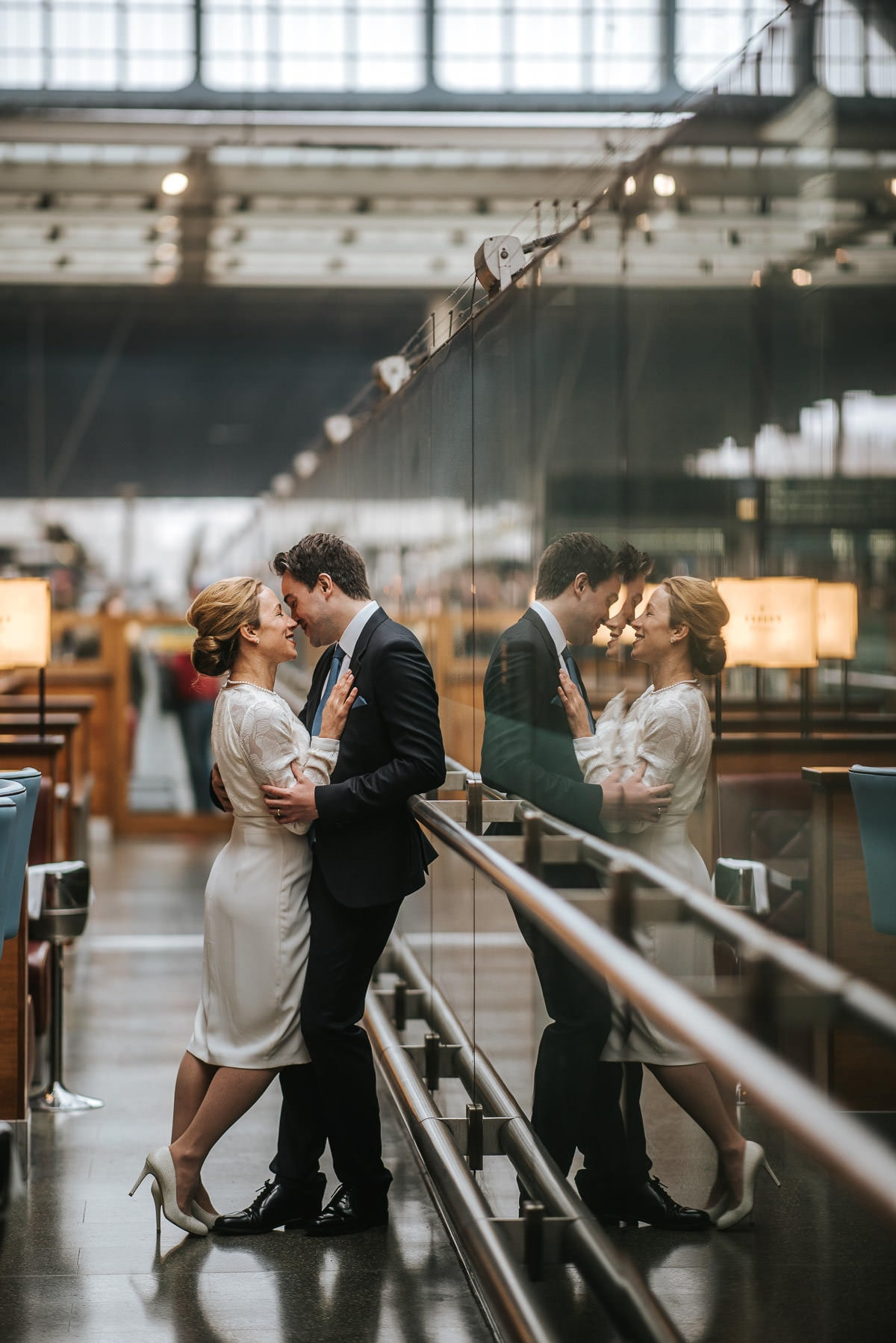 london engagement photography kings cross couple hugging at the train station