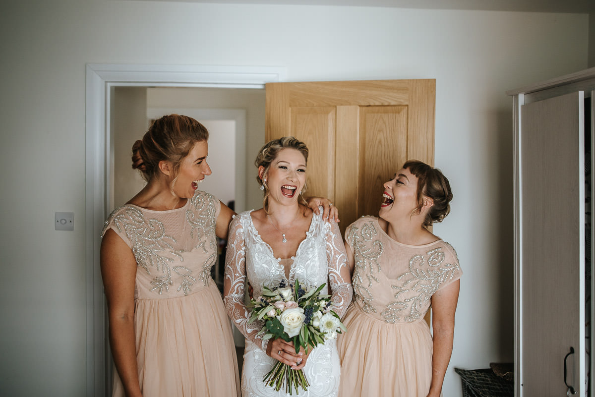 islington town hall wedding bride and bridesmaids laughing