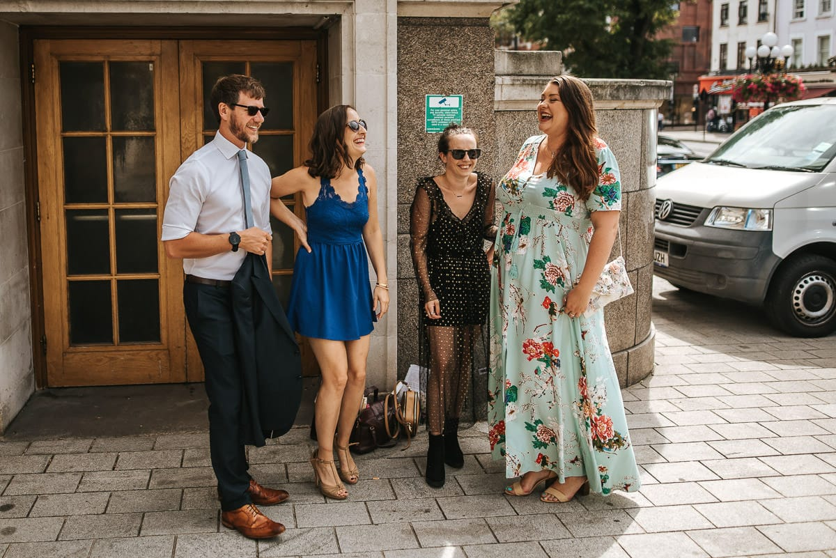 islington town hall wedding guests laughing