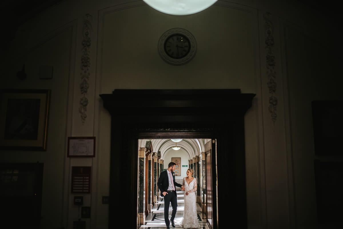 islington town hall wedding couple walking