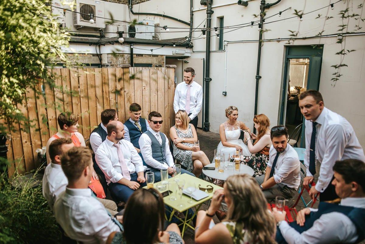 islington town hall wedding brookmill pub reception guest chatting outside