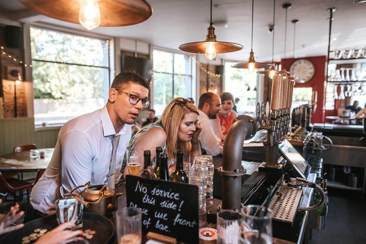 islington town hall wedding brookmill pub reception guests ordering drinks