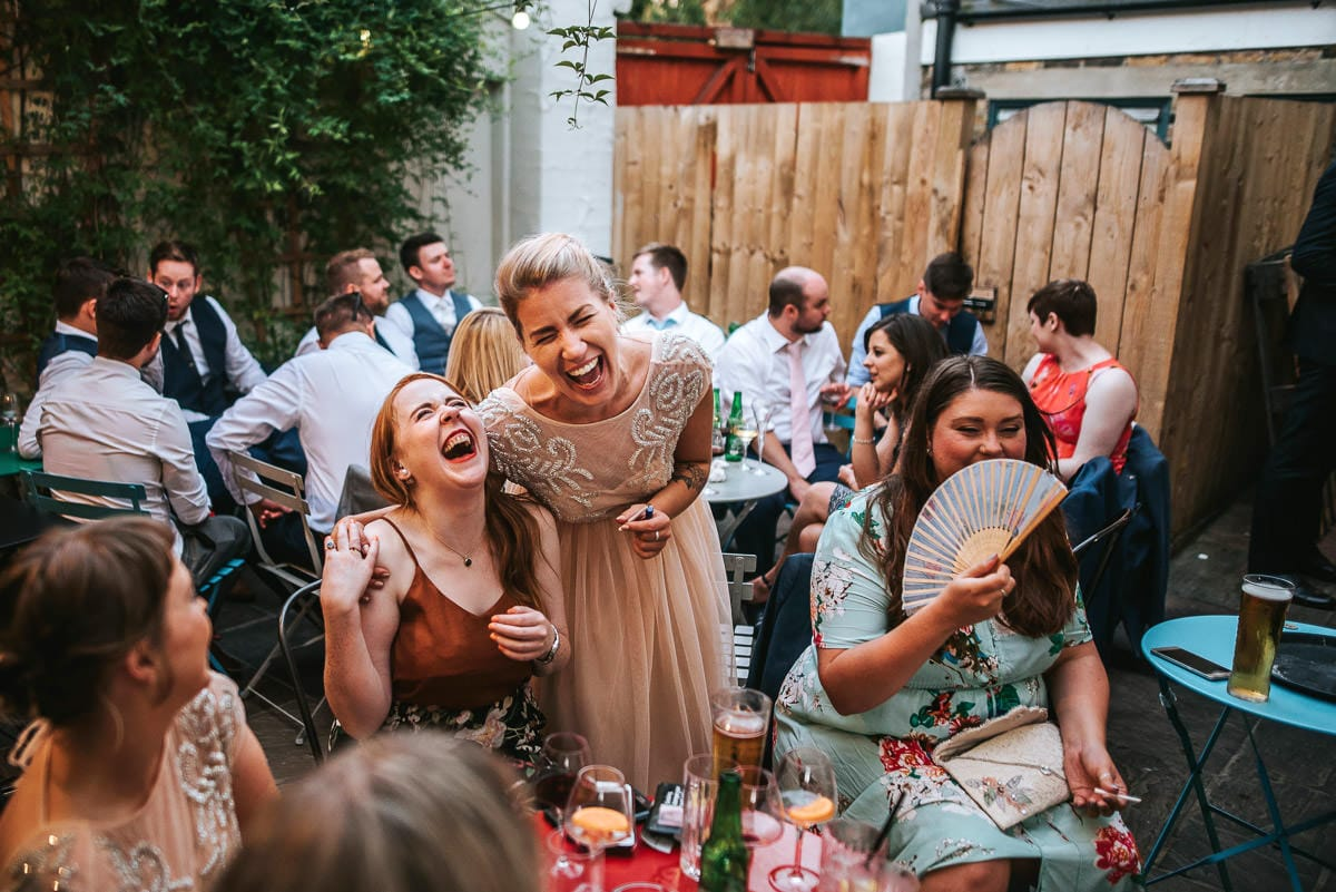 islington town hall wedding brookmill pub reception guests laughing