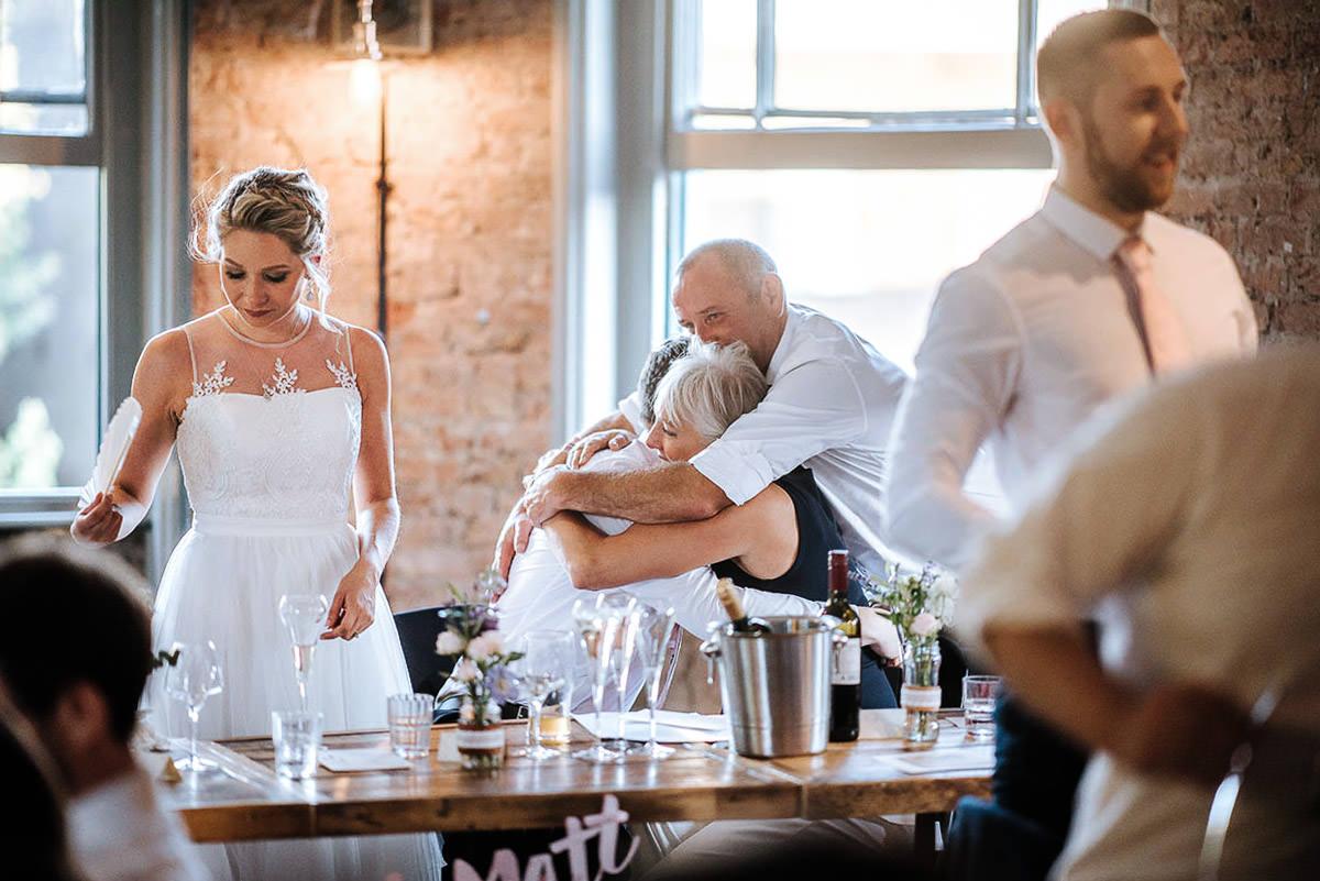 wedding brookmill pub reception group hug