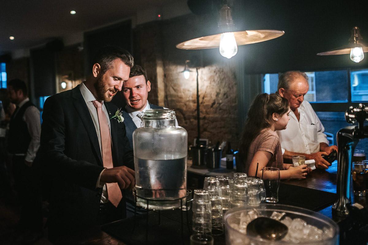 wedding brookmill pub reception groom by the bar