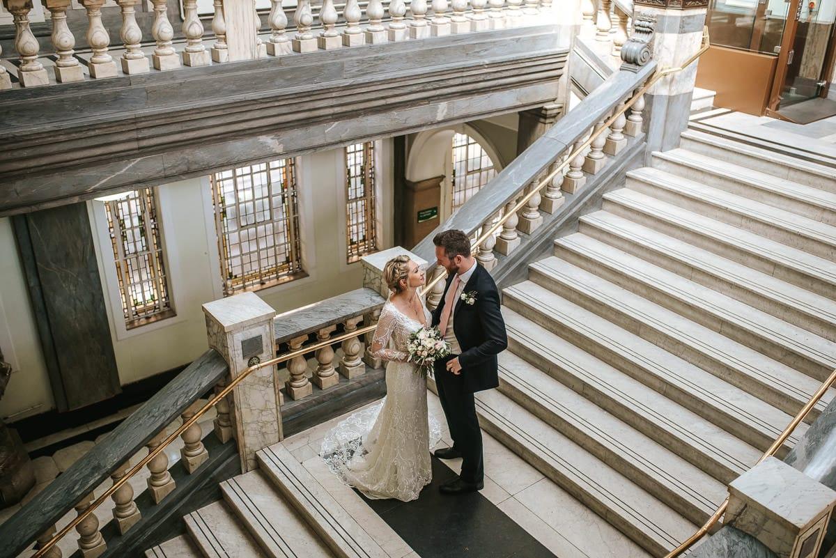 islington town hall wedding couple standing on the steps