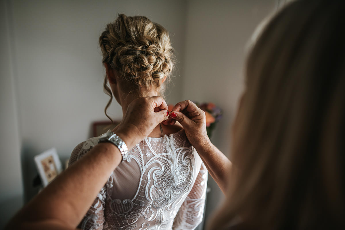 islington town hall wedding photography putting the dress on