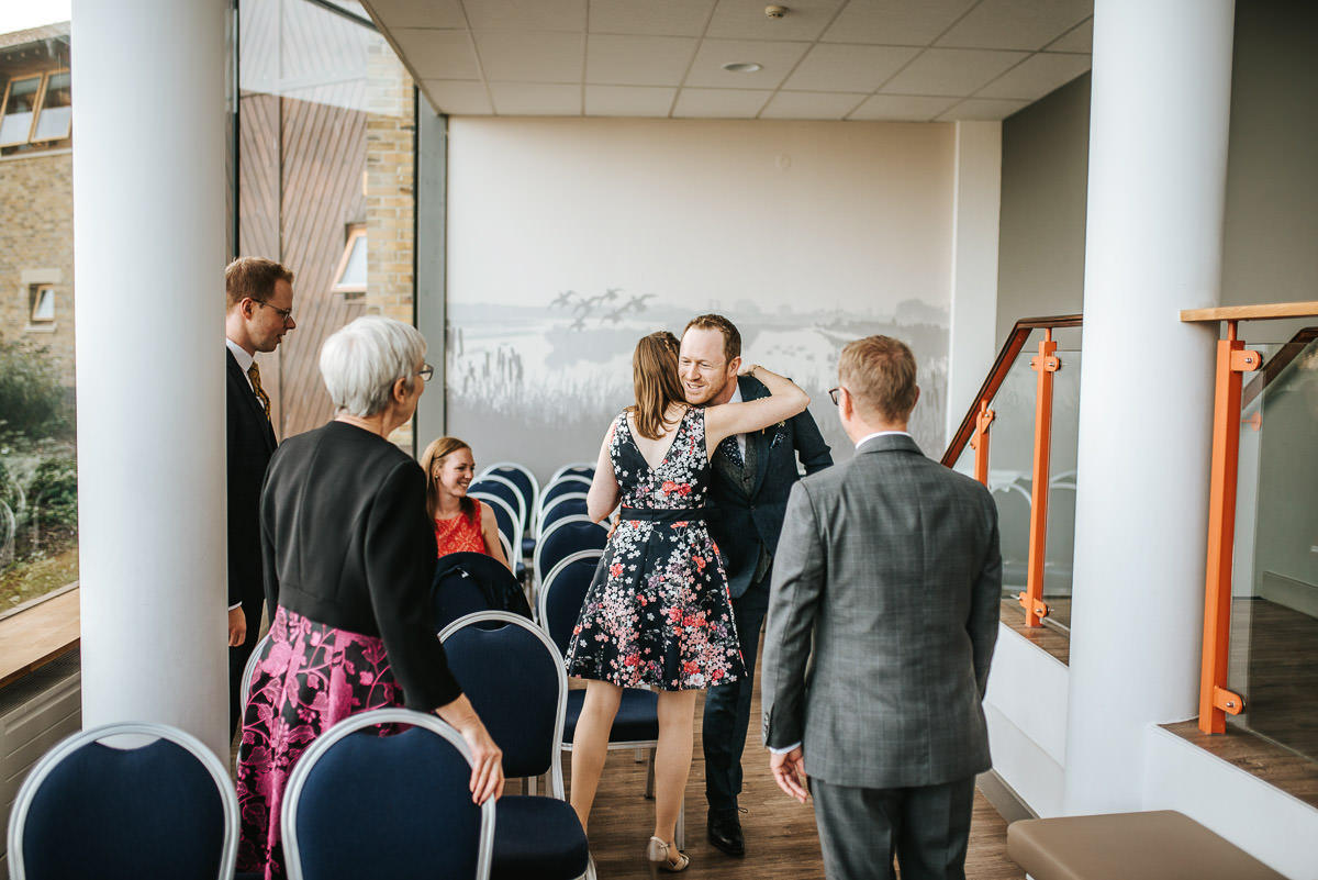 london wetland centre wedding groom greeting guests