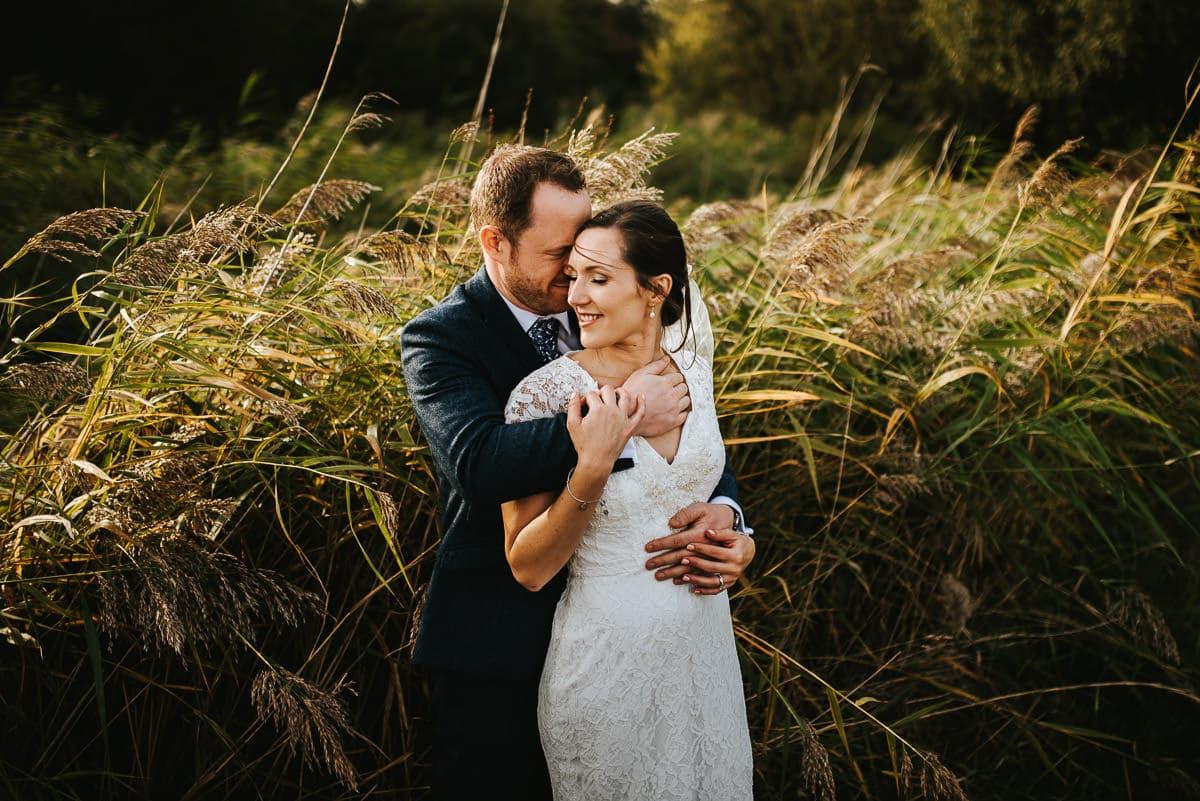 london wetland centre wedding bride and groom embracing