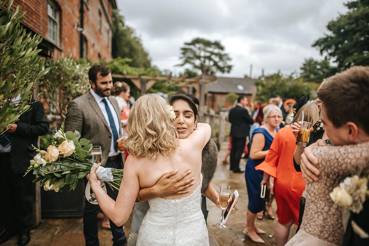sopley mill wedding drinks reception hugs